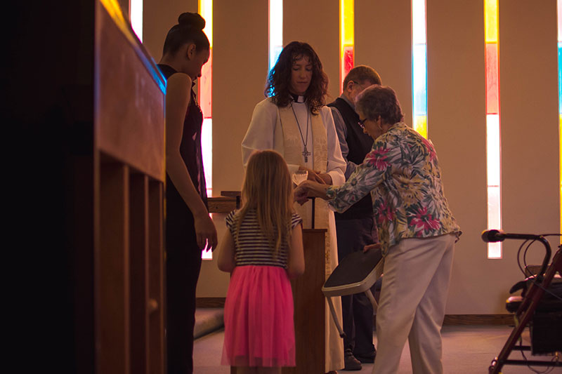A child is baptized at Northlake Lutheran